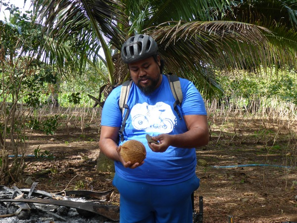 Jimmy opening a coconut, Rarotonga