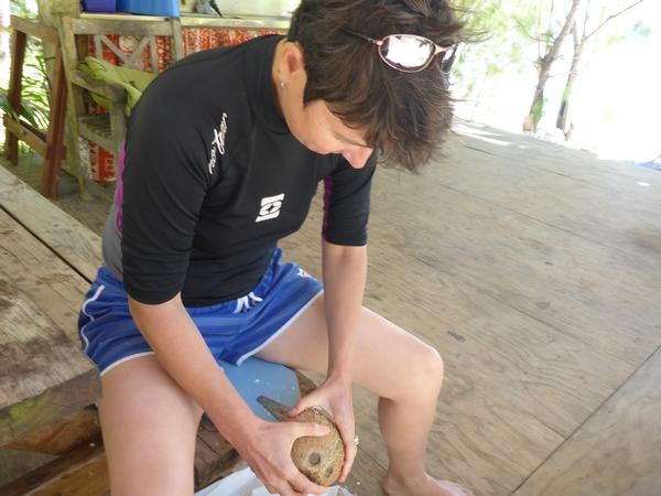 Grating coconut, at Vaikoa